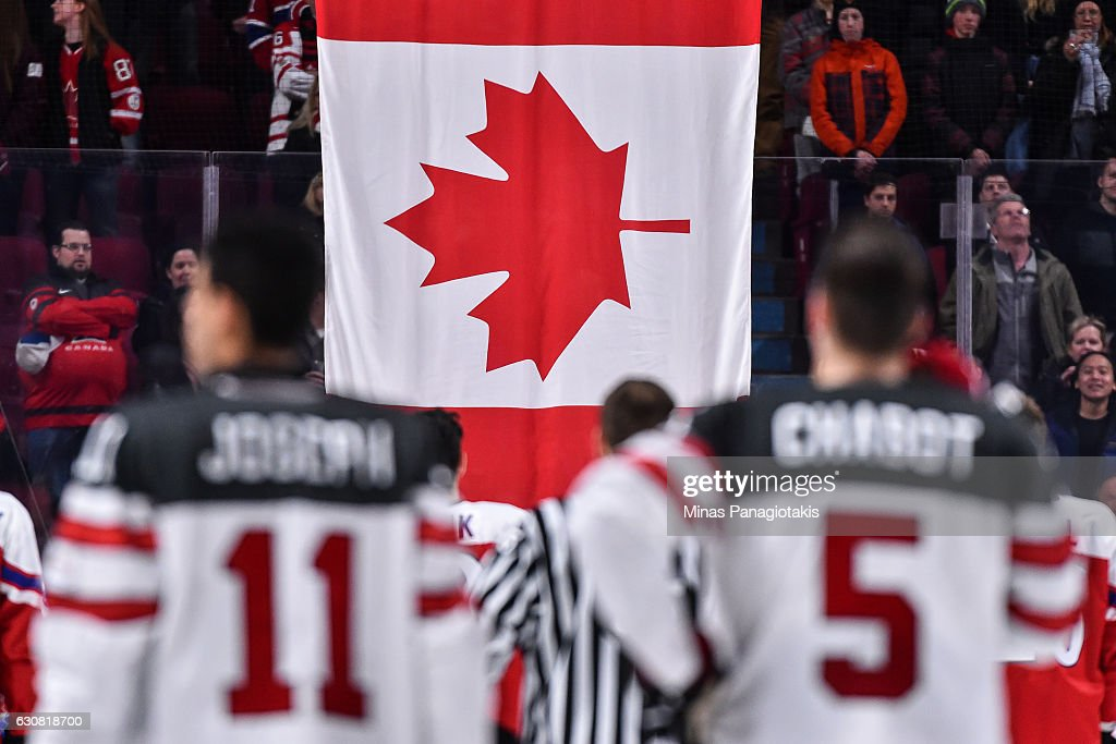 The Canadian flag is raised after Team Canada's victory over Team Czech Republic during the 2017 IIHF World Junior Championship quarterfinal game at the Bell Centre on January 2, 2017 in Montreal, Quebec, Canada. Team Canada defeated Team Czech Republic 5-3.