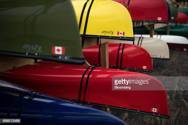 The Canadian flag is seen on canoes secured to a rack at the Holy Cow Canoe Co production facility in Guelph Ontario Canada on Thursday March 1 2018...