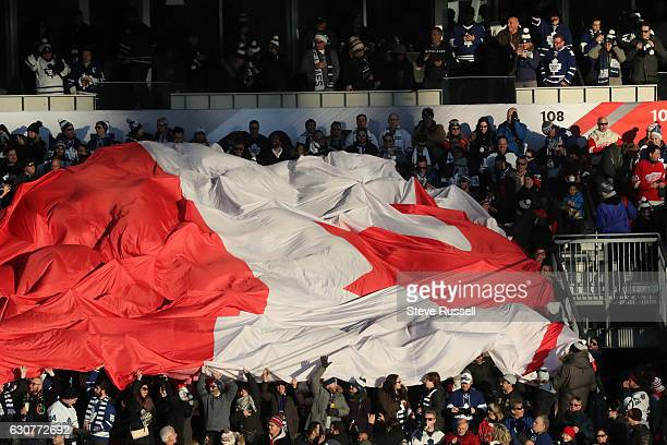 TORONTO ON JANUARY 1 The Canadian flag makes its way across the fans as the Toronto Maple Leafs play the Detroit Red Wings alumni in the Centennial...