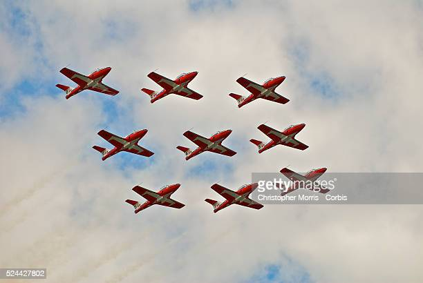 The Canadian Forces Snowbirds Air Force aerial acrobatic team puts on a show in the air above the crowd at the Formula One Grand Prix of Canada at...