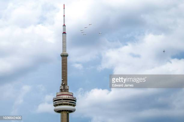 The Canadian Forces Snowbirds fly past the CN Tower in the skies of Toronto during the 69th Canadian International Air Show on September 3 2018 in...