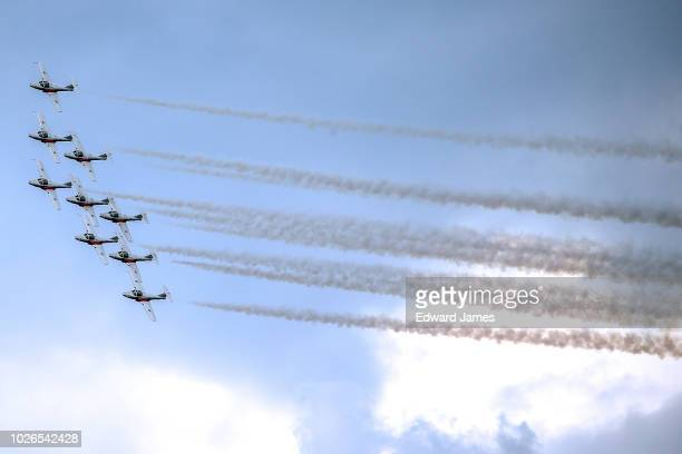 The Canadian Forces Snowbirds leave a trail of smoke as they fly over the skies of Toronto during the 69th Canadian International Air Show on...
