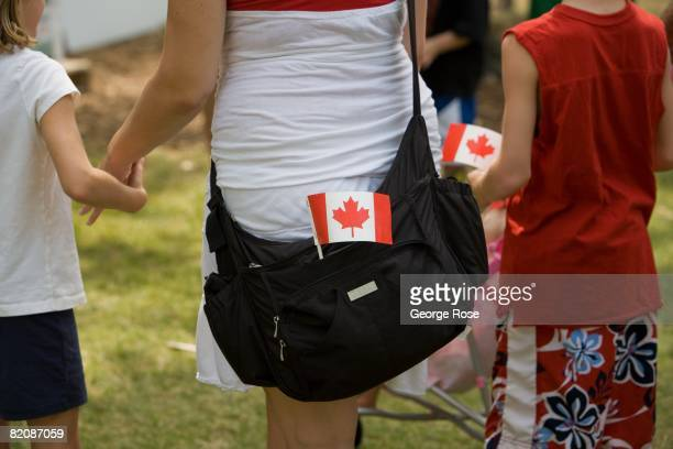 The Canadian maple leaf flag is tuckedinto a backpack of an attendee during Canada Day festivities in this 2008 Penticton British Columbia Canada...