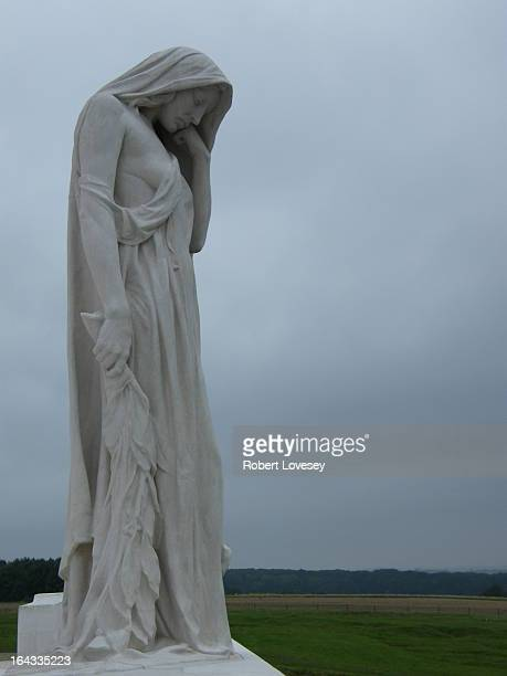 The Canadian National Vimy Memorial which overlooks the Douai Plain, with the slag heaps of Loos in the distance. Designed by Canadian sculptor and...