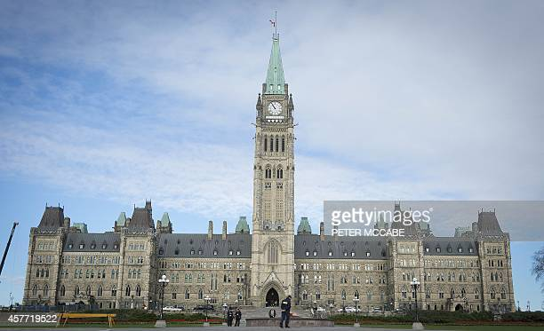 The Canadian Parliament is seen on October 23 in Ottawa, the day after multiple shootings in the capital city and Parliament buildings left a soldier...