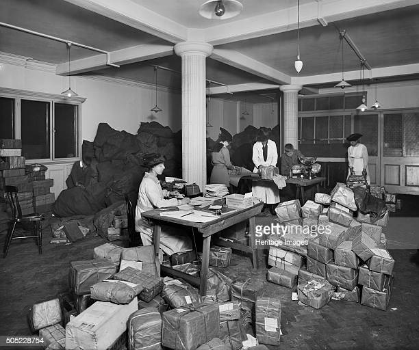 The Canadian Red Cross Society, 15A Pall Mall, Westminster, London, January 1917. Women packing parcels intended for prisoners of war. Artist: H...