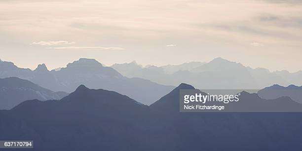 the canadian rockies viewed from the top of the east end of mt rundle, alberta, canada - two dimensional shape stock photos and pictures