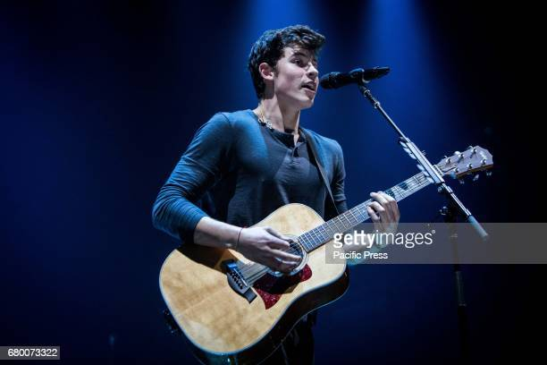 The Canadian singer and songwriter Shawn Mendes pictured on stage as he performs at Mediolanum Forum Assago