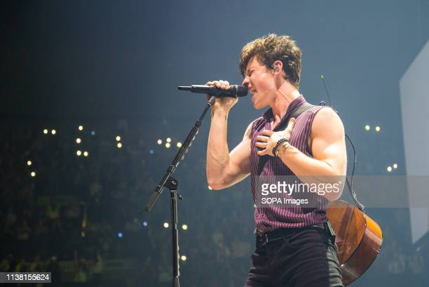 The Canadian singer and songwriter Shawn Mendes seen performing live on stage at the Pala Alpitour in Turin
