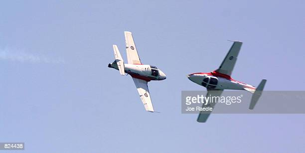 The Canadian Snowbird team performs aerobatic maneuvers May 6 2001 on day two of the twoday Air Sea Show's salute to the US military in Ft Lauderdale...