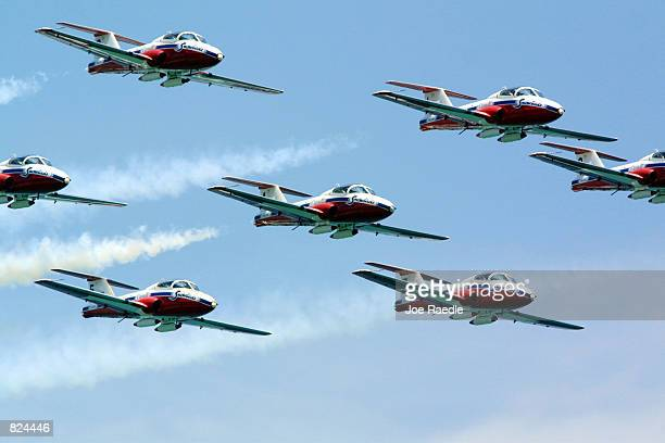 The Canadian Snowbird team performs aerobatic maneuvers May 6, 2001 on day two of the two-day Air & Sea Show's salute to the U.S. Military in Ft....