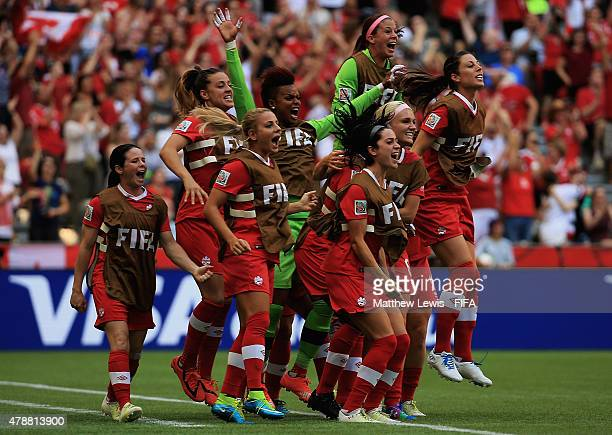 The Canadian team celebrate Christine Sinclair of Canada's goal during the FIFA Women's World Cup 2015 Quarter Final match between England and Canada...