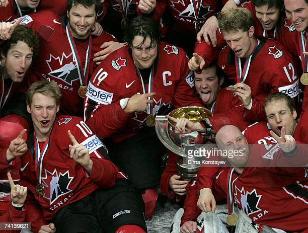 The Canadian team jubilates with the trophy after defeating team Finland 42 during the IIHF World Ice Hockey Championship final match between Canada...