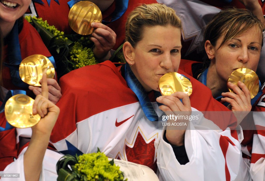 The Canadian team show off their gold medals during the medals ceremony in the Woman's Ice Hockey games at the Canada Hockey Place during the XXI Winter Olympic Games in Vancouver, Canada on February 25, 2010. Canada beat the USA 2-0 to win the gold and Finland beat Sweden 3-2 to win the bronze.