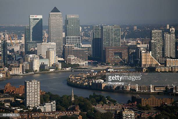 The Canary Wharf business financial and shopping district top stands beyond the River Thames seen from the Leadenhall Building also known as the...