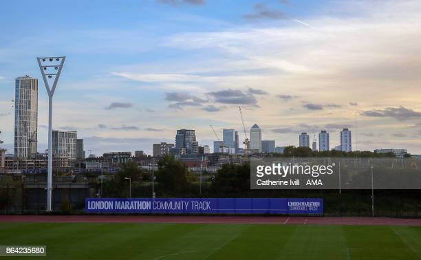 The Canary Wharf skyline can be seen behind The London Marathon community running track at the Queen Elizabeth Park before the Premier League match...