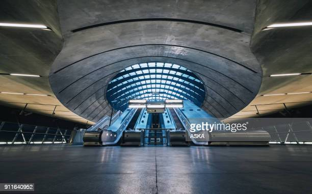 the canary wharf tube station , london - escalator stock pictures, royalty-free photos & images