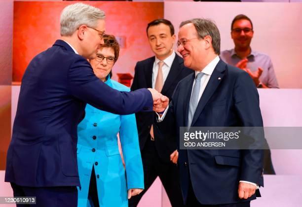 The candidate as leader of the Christian Democratic Union Norbert Roettgen congratulates winner North Rhine-Westphalia's State Premier Armin Laschet...