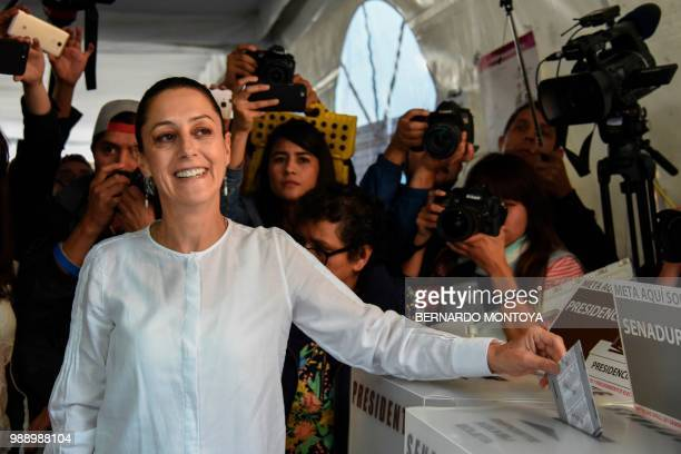 The candidate for governor for Mexico City Claudia Sheinbaum of the 'Juntos haremos historia' coalition party casts her vote during the general...