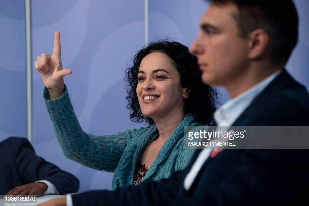 The candidate for Governor of Rio de Janeiro for the Workers Party Marcia Tiburi makes a signal in support of jailed Brazilian former president Luiz...