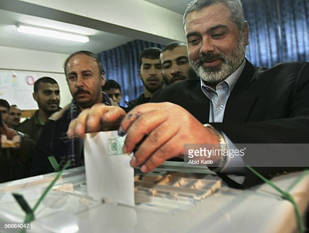 The candidate for The Islamic Resistance Movement Hamas Ismael Hanyeh casts his vote in the Palestinian legislative election in the UN school Alef...