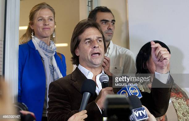 The candidate for the National Party Luis Lacalle Pou the 40yearold son of former president Luis Alberto Lacalle speaks next to his wife Lorena Ponce...