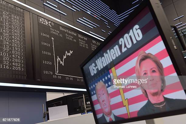 The candidates Donald Trump and Hillary Clinton of US presidential elections are seen on a TV screen below the graph showing the day's course of the...