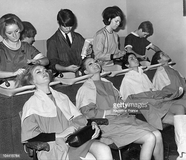 The candidates to the MISS WORLD title getting shampooed a day before the contest in a hairsalon at Picadilly in London on November 16 1966