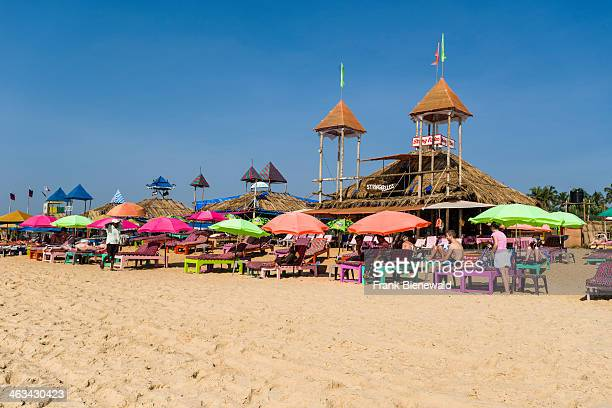 The Candolim Beach with umbrellas white sand and blue sky is one of the famous beaches in the former Portuguese colony Goa