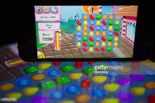 The Candy Crush Saga game is displayed on an Apple Inc iPhone 5s and iPad Air in this arranged photograph in Washington DC US on Tuesday Feb 18 2014...
