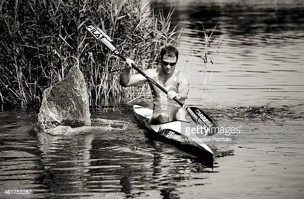 The canoeist Antonio Rossi rowing during a photo shooting Lago di Pusiano Italy 2008