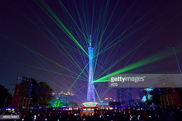 The Canton Tower is illuminated during the Lunar New Year flower market opening ceremony on January 27 2014 in Guangzhou China Chinese people are...