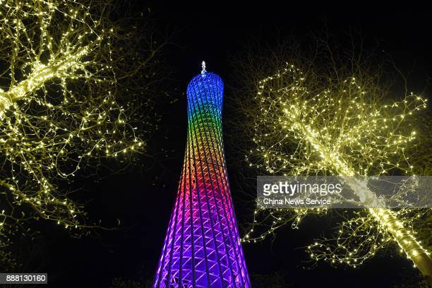 The Canton Tower lights up during a welcoming banquet on day two of the 2017 Fortune Global Forum on December 7 2017 in Guangzhou Guangdong Province...