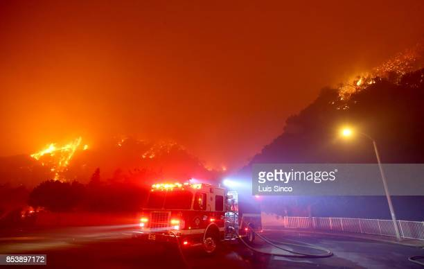 The Canyon Fire burns in the hills surrounding a neighborhood on September 25 2017 in Corona California The fire charred about 1500 acres by Monday...