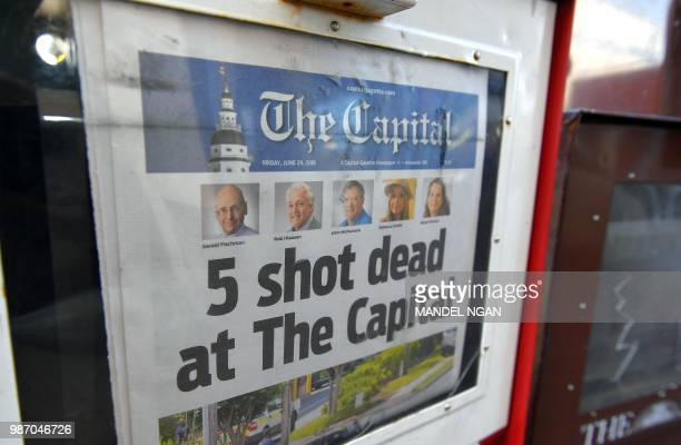 The Capital Gazette of June 29 is seen in a newspaper vending box in Annapolis Maryland A man armed with a shotgun and smoke grenades burst into the...