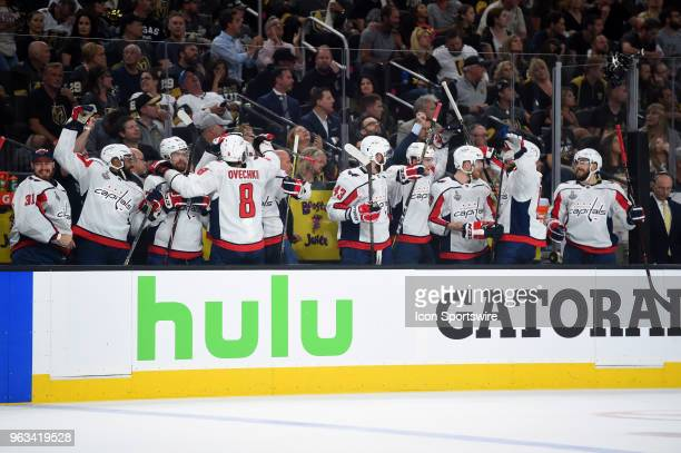 The Capitals bench celebrates after scoring their second goal of the game in the first period during game 1 of the Stanley Cup Final between the...