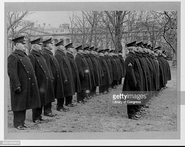 The Capitol Police stand at attention in their new uniforms on the White House grounds in Washington D C | Location White House grounds Washington D...