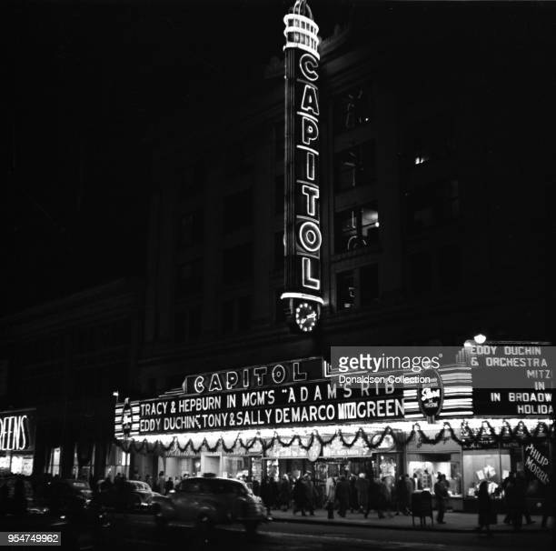 The Capitol Theater marquee on Broadway reads Tracy and Hepburn in MGM's 'Adam's Rib' Eddy Duchin Tony and Sal DeMarco Mito Green on November 18 1949...
