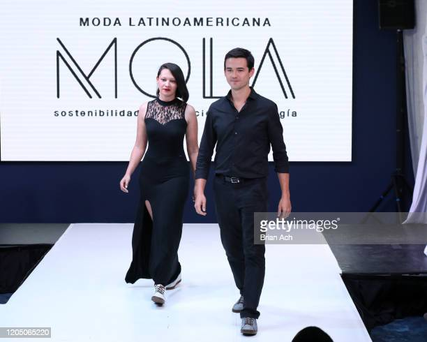 The Cappaz designers walk the runway wearing EILEAN during NYFW Powered By hiTechMODA on February 08, 2020 in New York City.