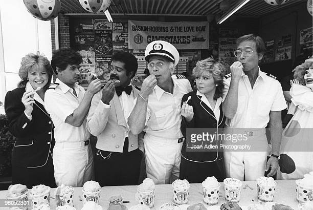 The Captain and crew of the television series 'The Love Boat' take a break in the taping of the show to sample some of the 31 flavors from...