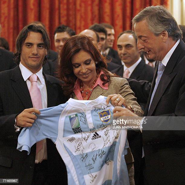 The captain of Argentina's rugby team Los Pumas Agustin Pichot gives a jersey signed by the team members to First Lady and presidential candidate,...