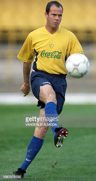 The captain of Brazil's soccer team Antonio Carlos passes the ball during a practice in Maracana Stadium in Rio de Janeiro Brazil 27 June 2000 Brazil...