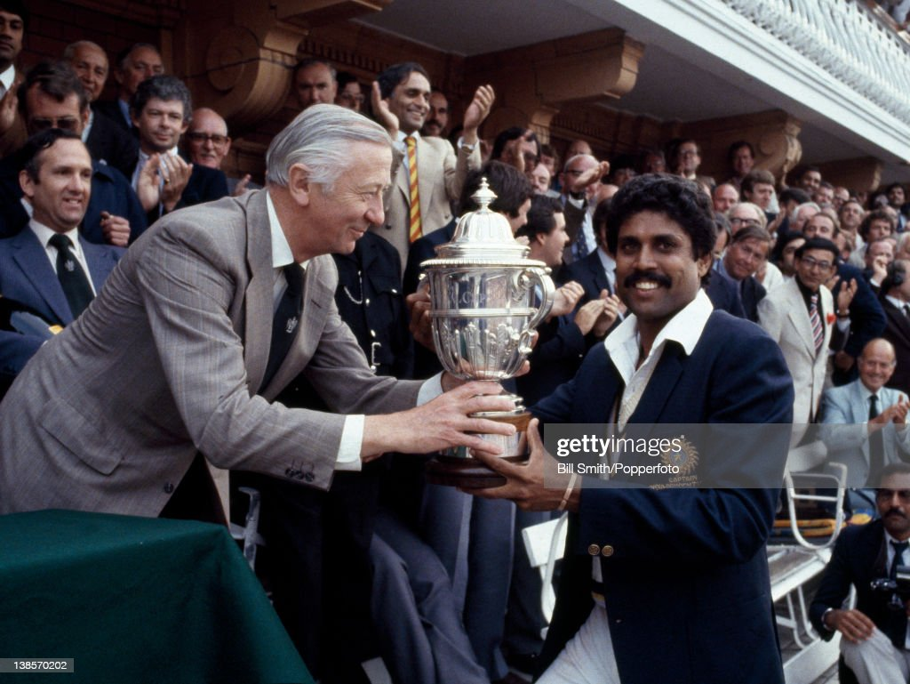 The captain of India, Kapil Dev, receives the Prudential World Cup Trophy from the Chairman of Prudential Assurance, Lord Carr of Hadley, after India's victory over the West Indies in the World Cup Final at Lord's cricket ground in London, 25th June 1983. India won by 43 runs.