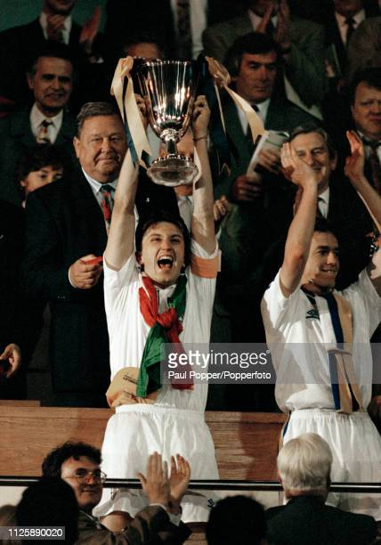 The captain of Parma Lorenzo Minotti lifts the trophy after the 1993 European Cup Winners Cup Final between Parma and Royal Antwerp at Wembley...