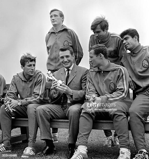 The captain of the 1954 World Cup winners Fritz Walter of West Germany holding a replica of the Jules Rimet trophy during a visit to meet the Spanish...
