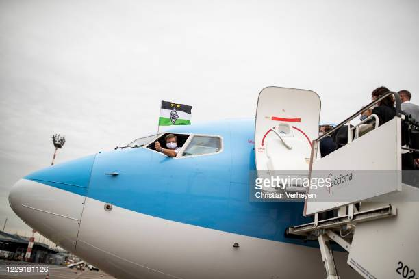 The captain of the airplane waves a Borussia flag during Borussia Moenchengladbach departs to the Group B UEFA Champions League match between FC...