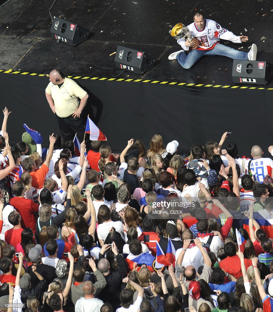 The captain of the Czech Ice hockey team Tomas Rolinek (TOP) performs with the Trophy as he celebrates with fans at the Old Town Square on May 24, 2010 in Prague. The Czechs returned from Cologne (Germany) where they won the ice hockey World Championships beating the Russians 2-1.