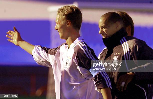 The captain of the German soccer team Christoph Preuss celebrates his teams victory over Canada 40 with his teammate Jermaine Jones 20 June 2001 as...