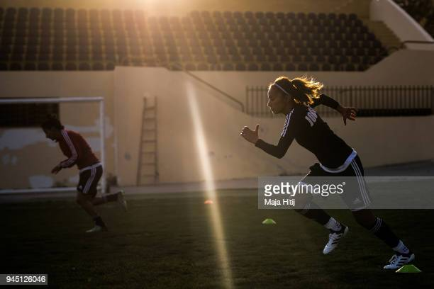 The Captain of the Jordanian Womens National Football Team Stephanie AlNaber is seen sprinting to warm up prior a test match against Jordans U15...