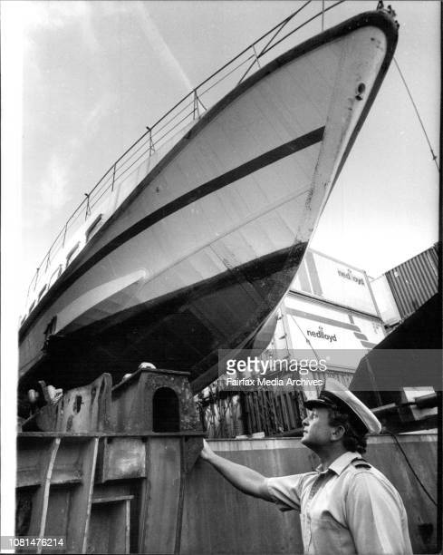 The captain of the OCL's Container Ship Botany Bay Captain Clive Short looks over Sydney's new $1 million hydrofoil after it's arrival at Athol Bight...